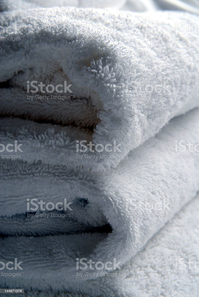 Closeup of towels with folds vert royalty-free stock photo