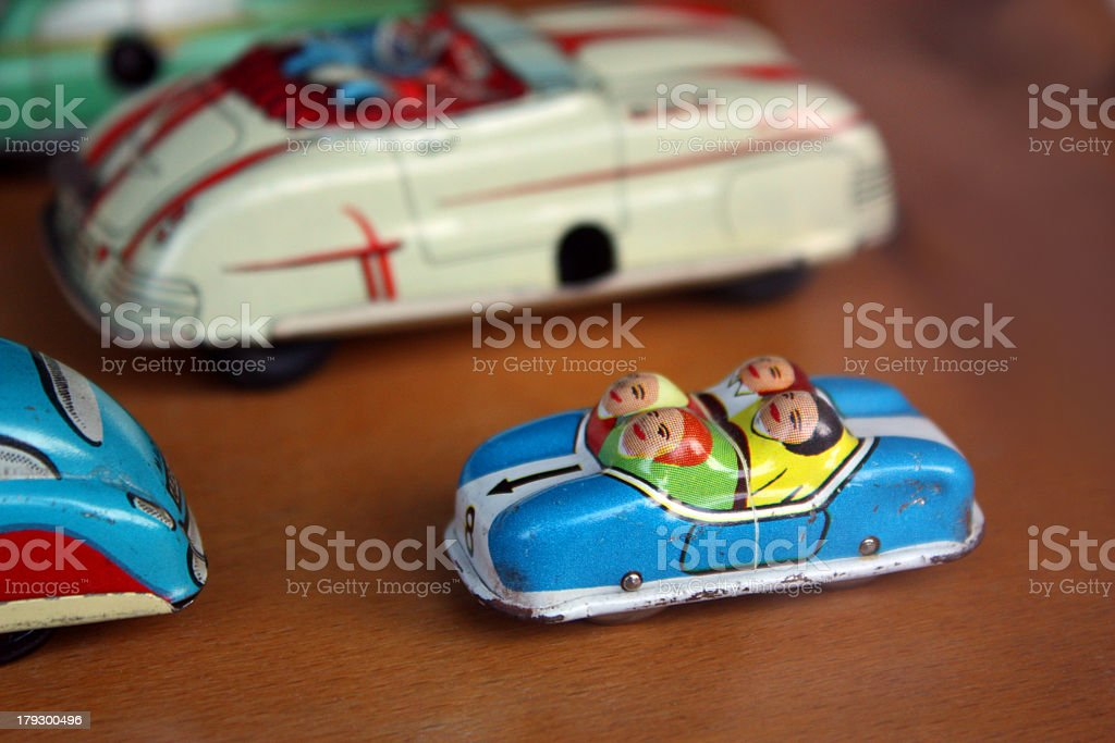 Close-up of toy car with four people sharing royalty-free stock photo