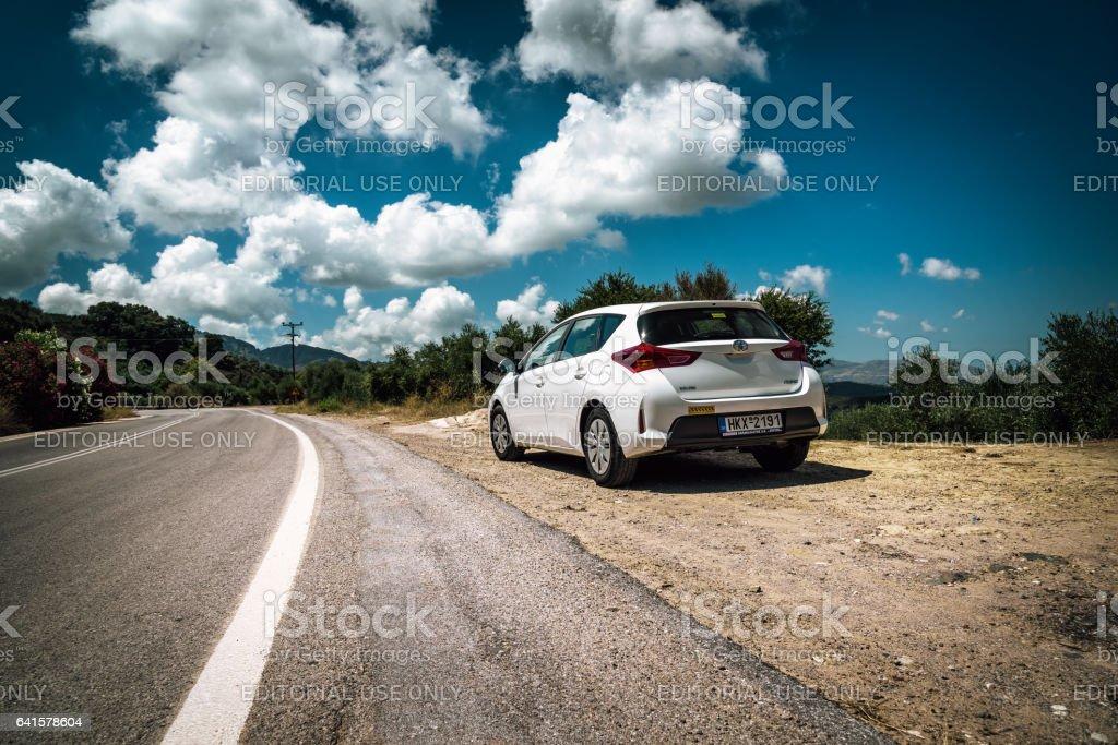Closeup of Toyota Auris staying among mountains stock photo