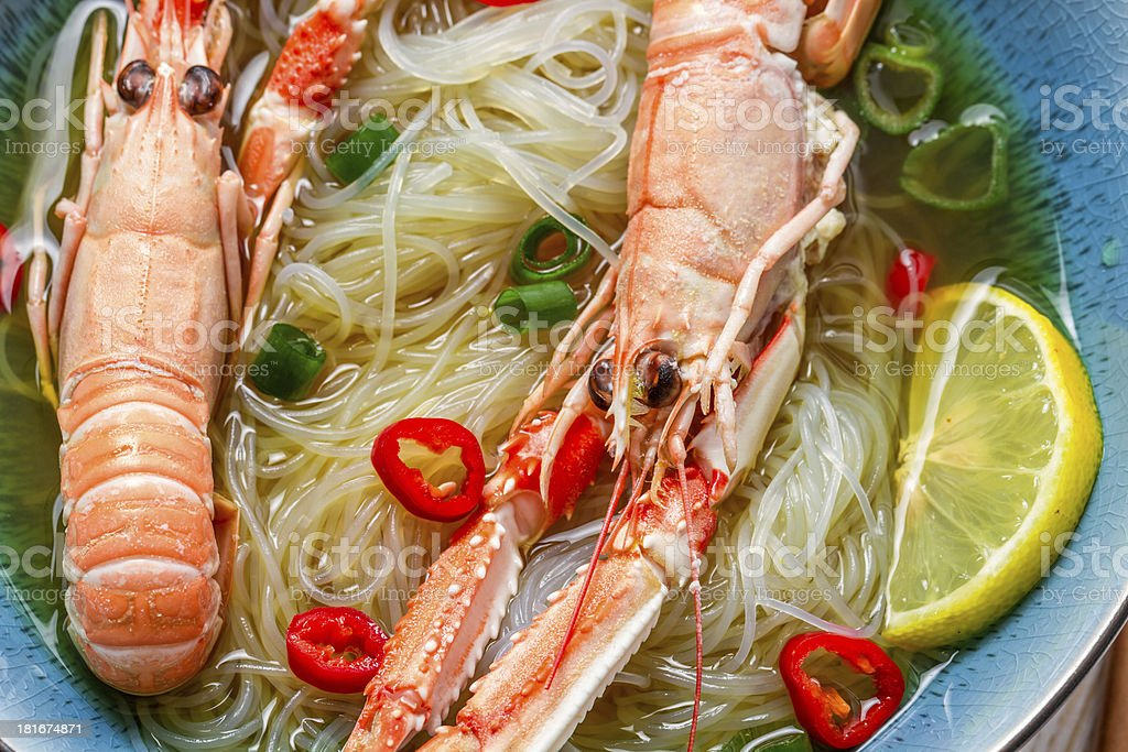 Closeup of traditional Thai soup with scampi royalty-free stock photo