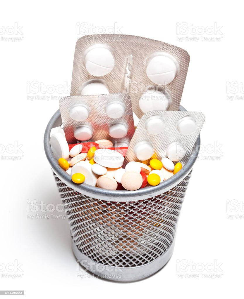 Close-up of trash can filled with a variety of pills stock photo