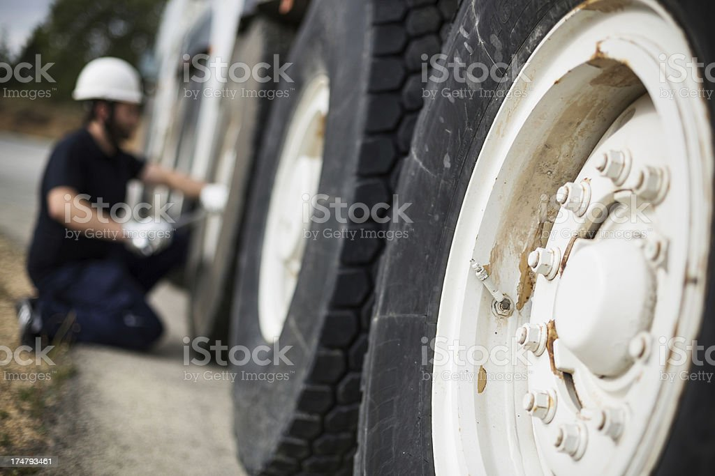 Close-up of truck tire with mechanic on the background stock photo