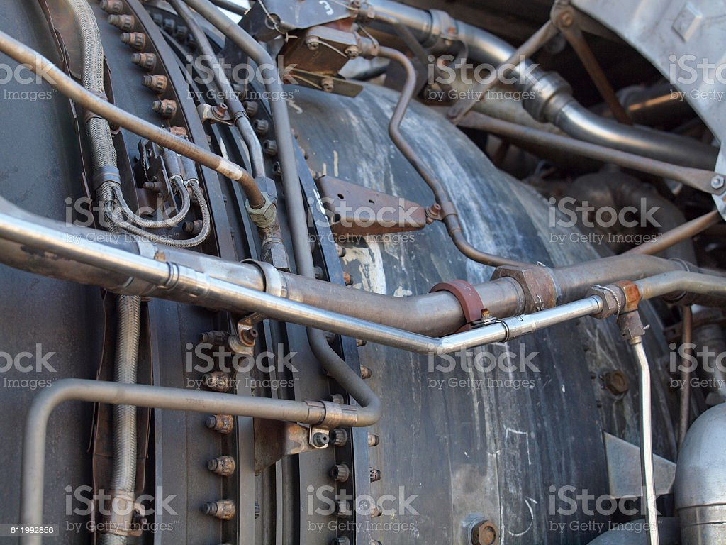 Close-up of tubes running along side of jet engine stock photo