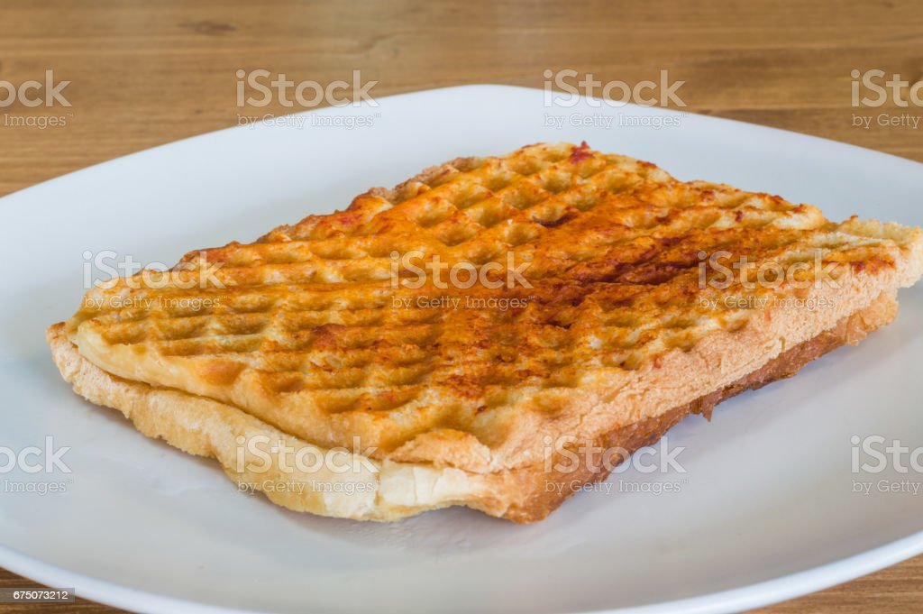 Closeup of Turkish toast, toasted sandwich with cheddar cheese stock photo
