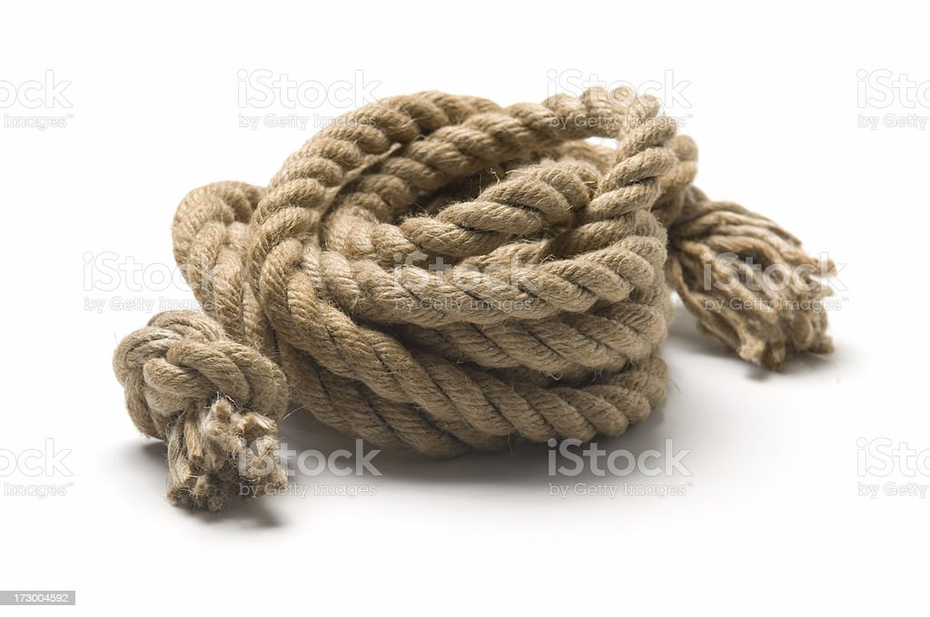 Close-up of twisted rope with white backdrop royalty-free stock photo
