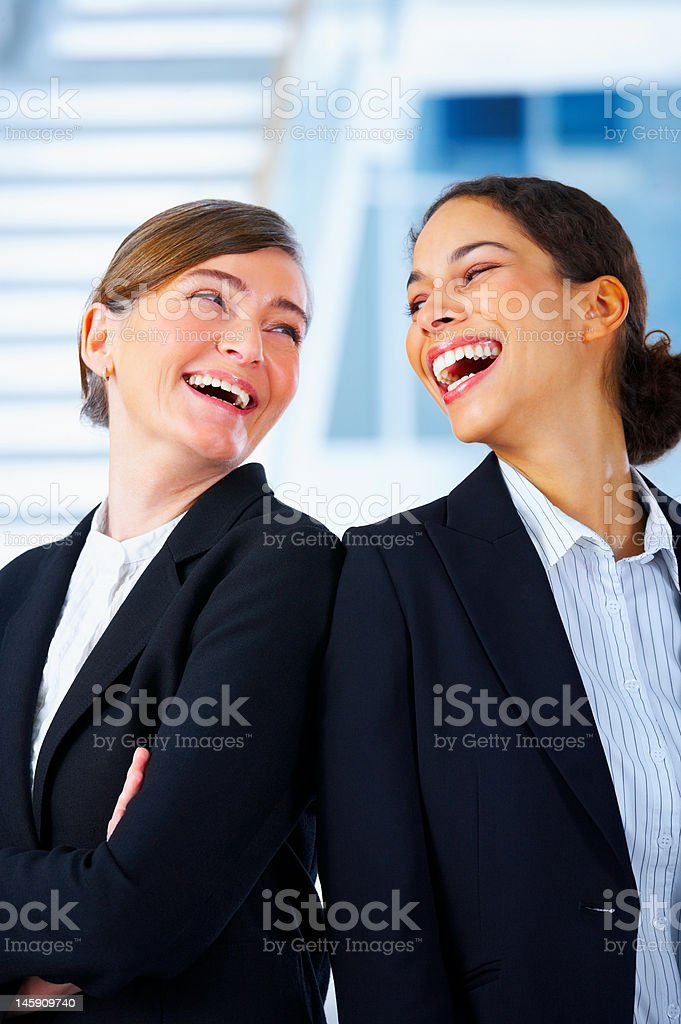 Close-up of two businesswomen smiling royalty-free stock photo