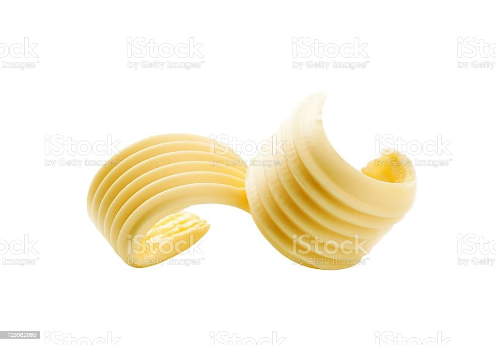 Closeup of two butter curls on white royalty-free stock photo