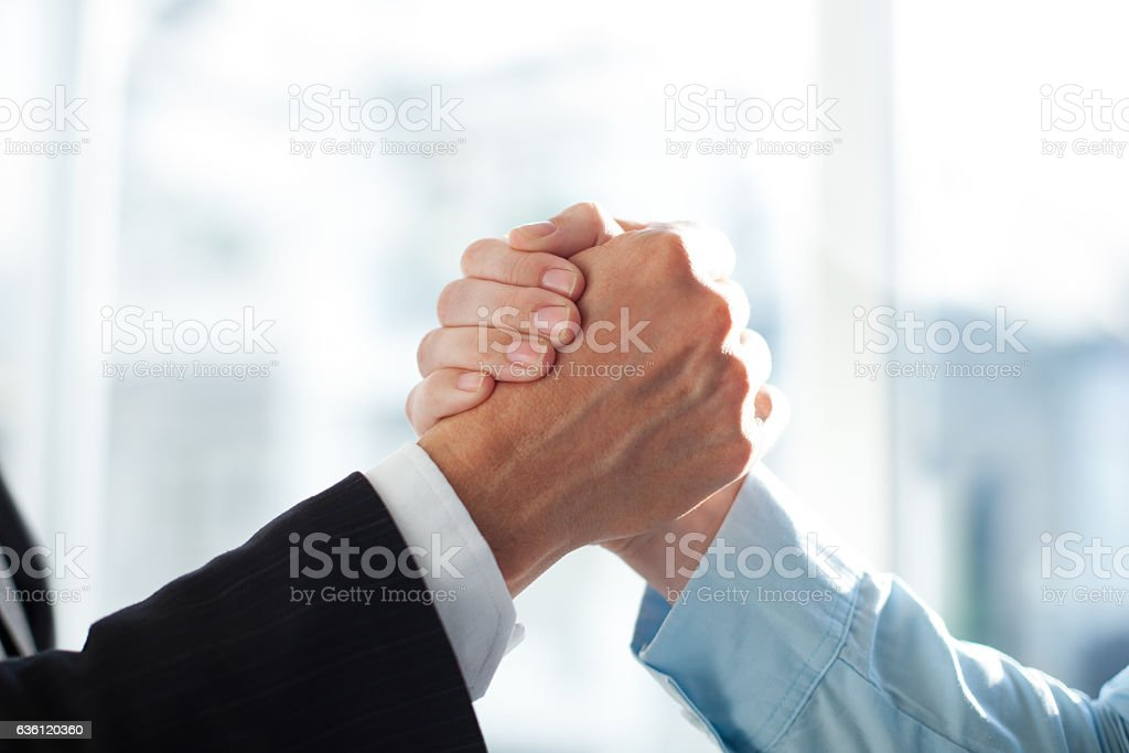 Close-up of two clasped hands of businessmen stock photo