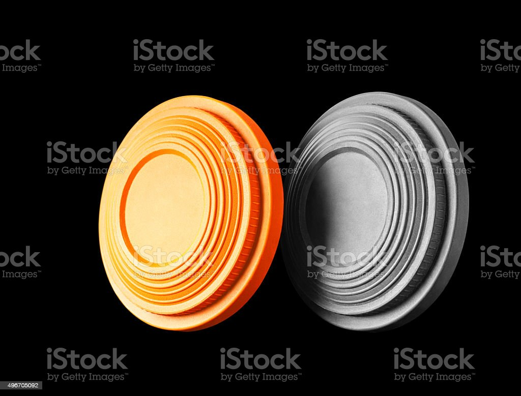 Closeup of two clay pigeon targets isolated on black background stock photo