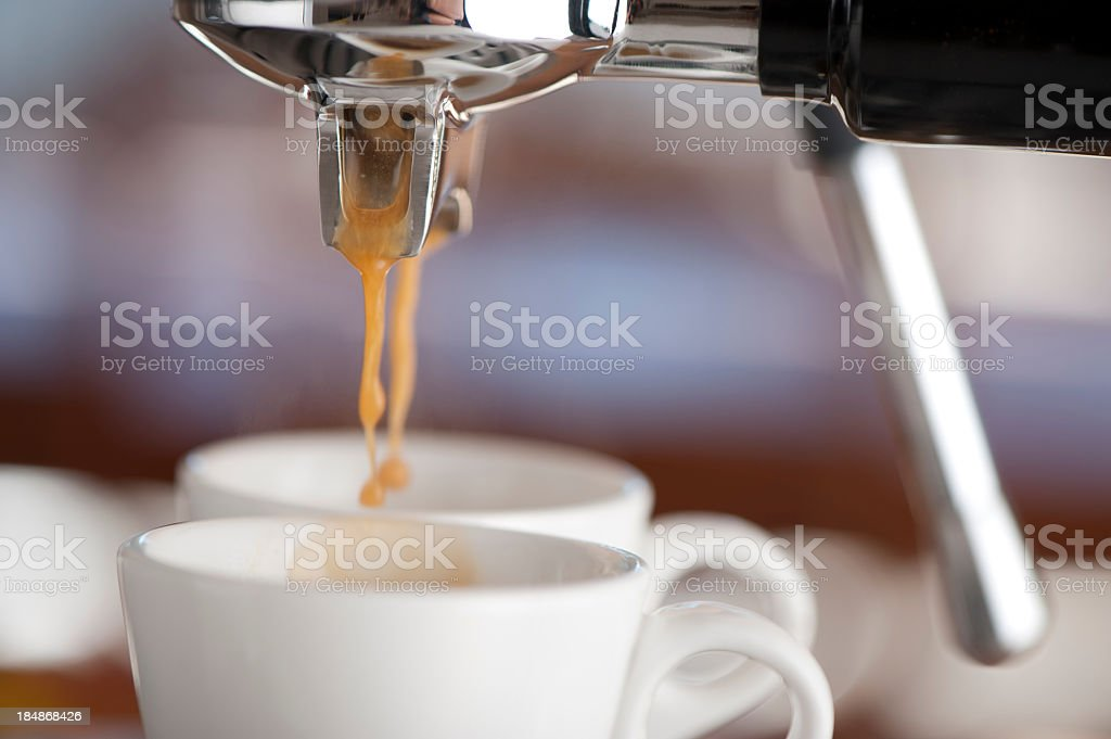 Close-up of two coffee cups in an espresso machine stock photo