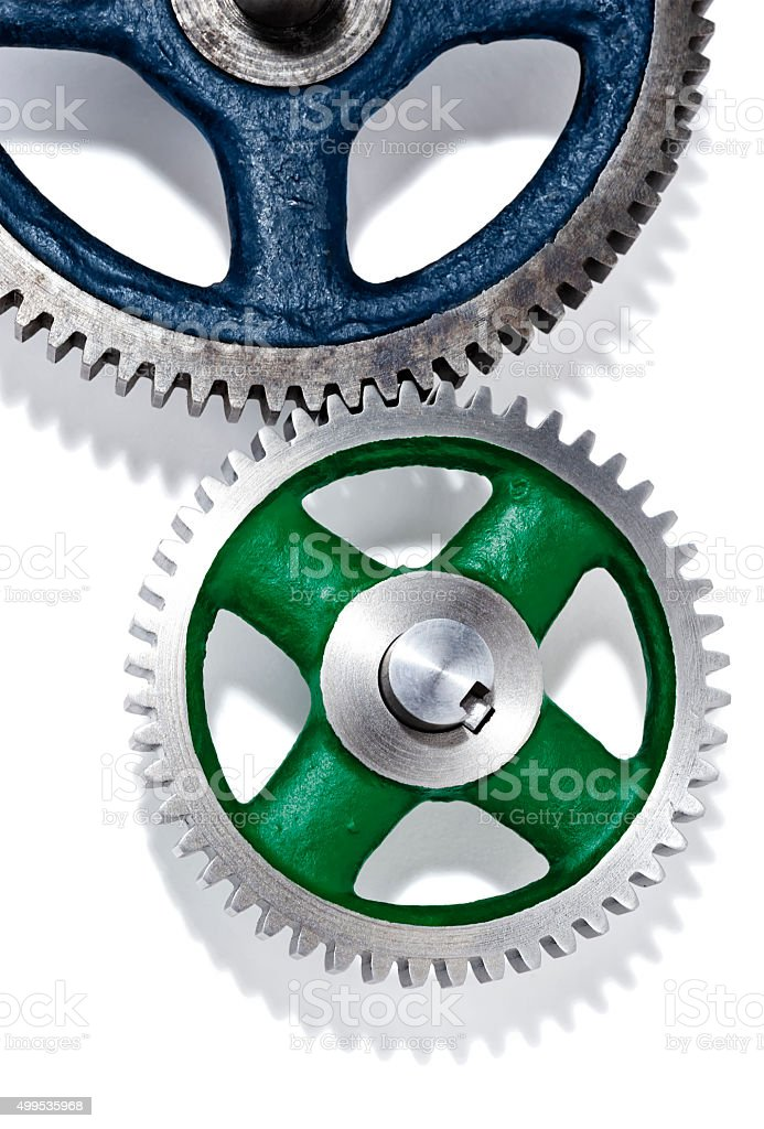 Close-up of two Gears of different size working together stock photo