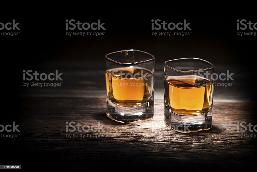 Close-up of two glasses of whiskey on wood table stock photo