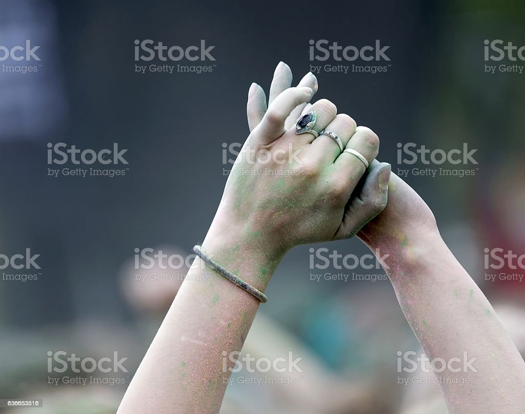 Closeup of two hands in the air, colorful background stock photo