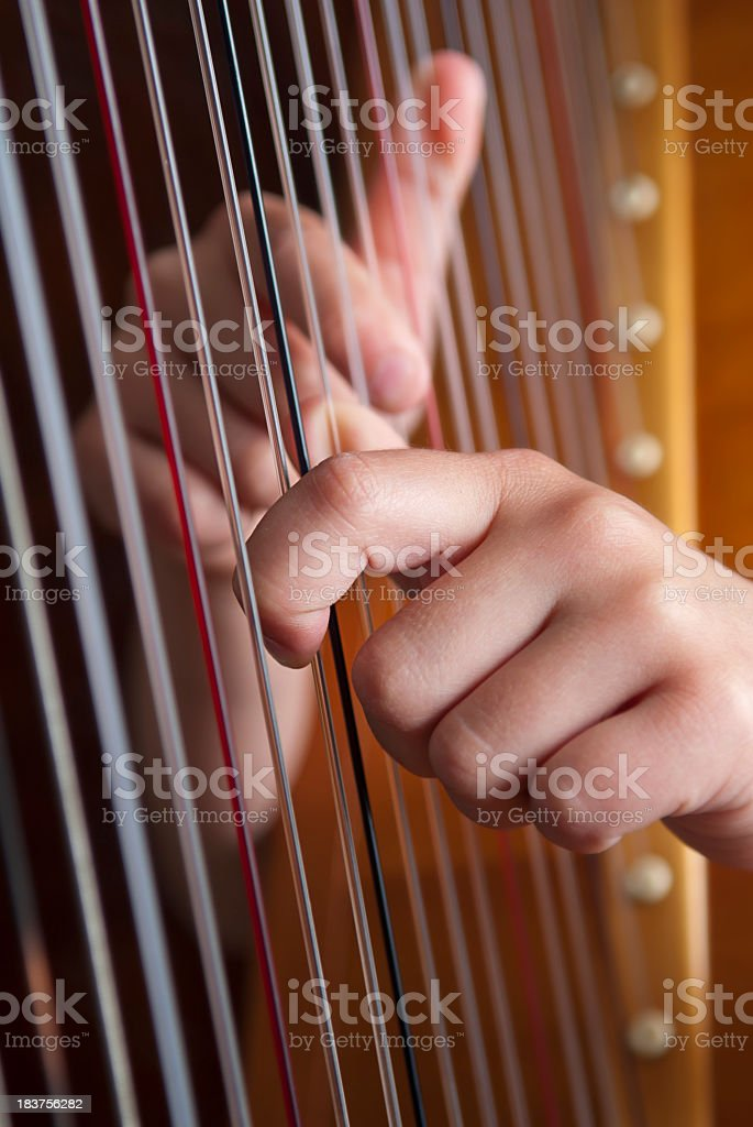 Close-up of two hands playing the harp stock photo