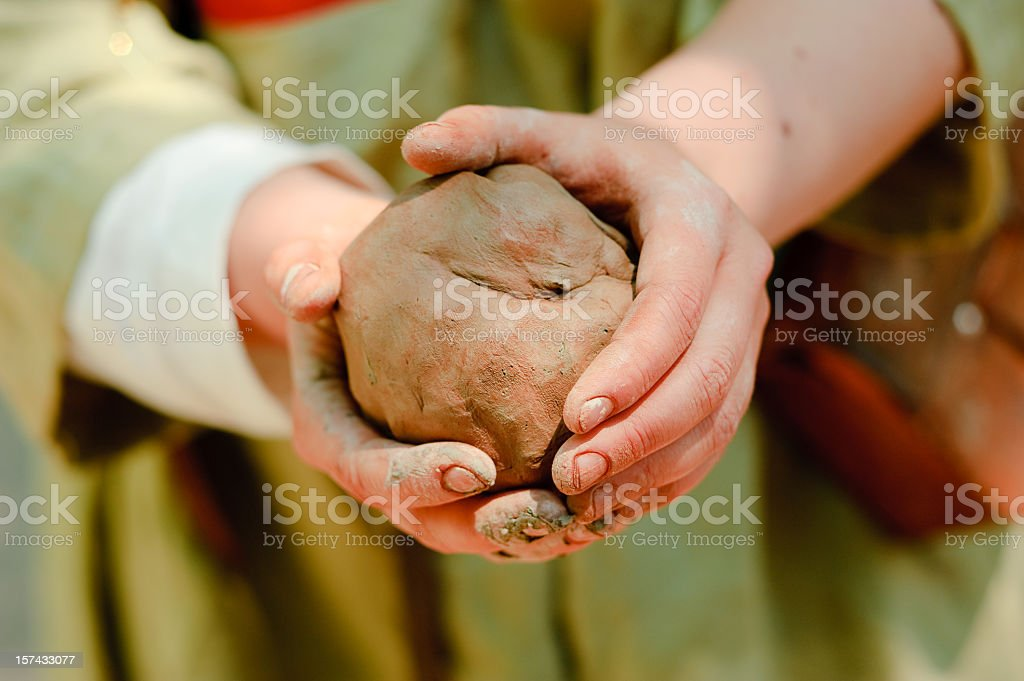 Close-up of two hands working with clay stock photo