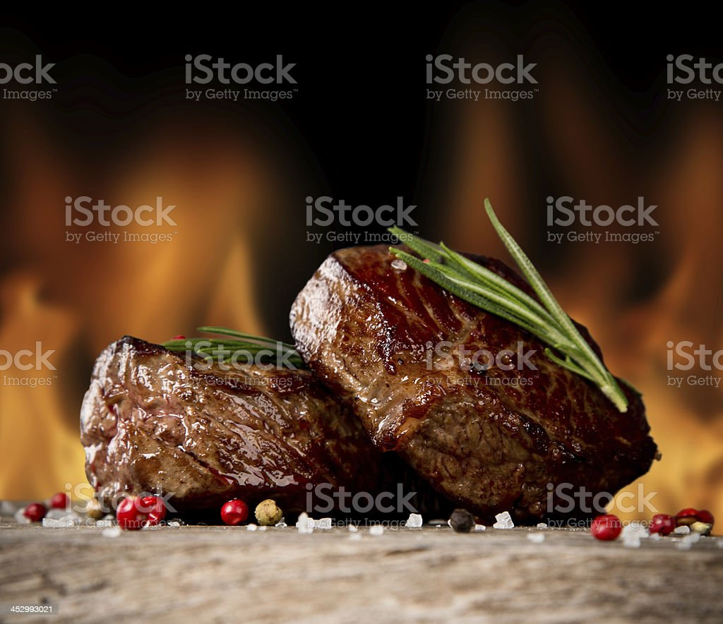 Close-up of two juicy beef steaks with garnish stock photo