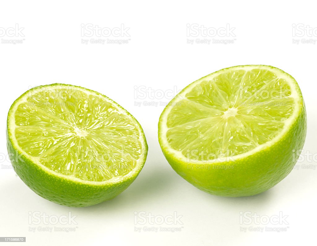 Close-up of two lime halves isolated on white royalty-free stock photo