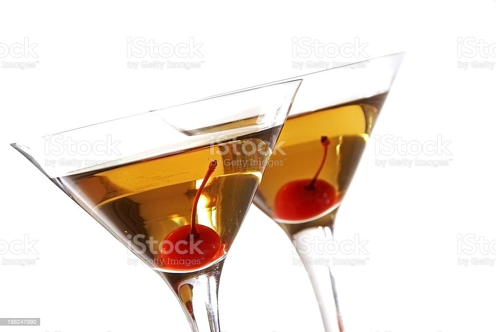 Close-up of two Manhattan cocktails with cherries in glasses stock photo