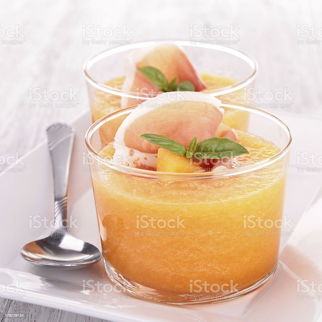 Close-up of two melon gazpacho cups on a serving dish stock photo