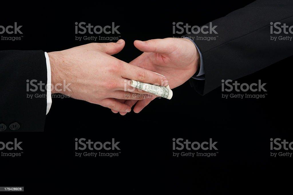 Close-up of two people performing a bribery money exchange royalty-free stock photo
