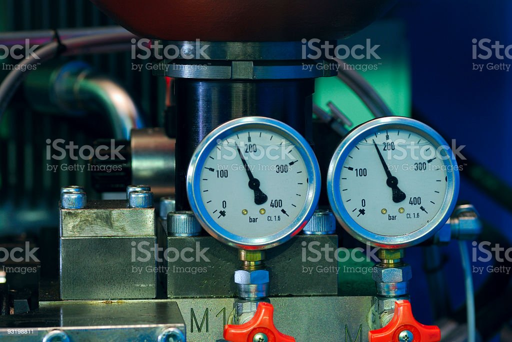 Close-up of two pressure gauges with red valves stock photo