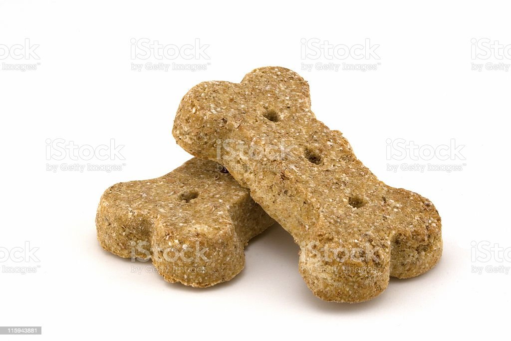 Closeup of two processed dog bone shaped dog treats stock photo
