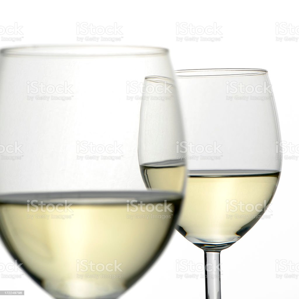 Close-up of two white wine glasses isolated on white, studio royalty-free stock photo