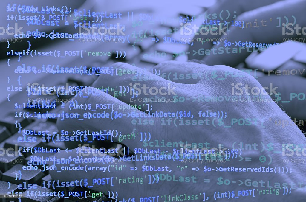 Close-up of typing male hands on keyboard and programming code stock photo