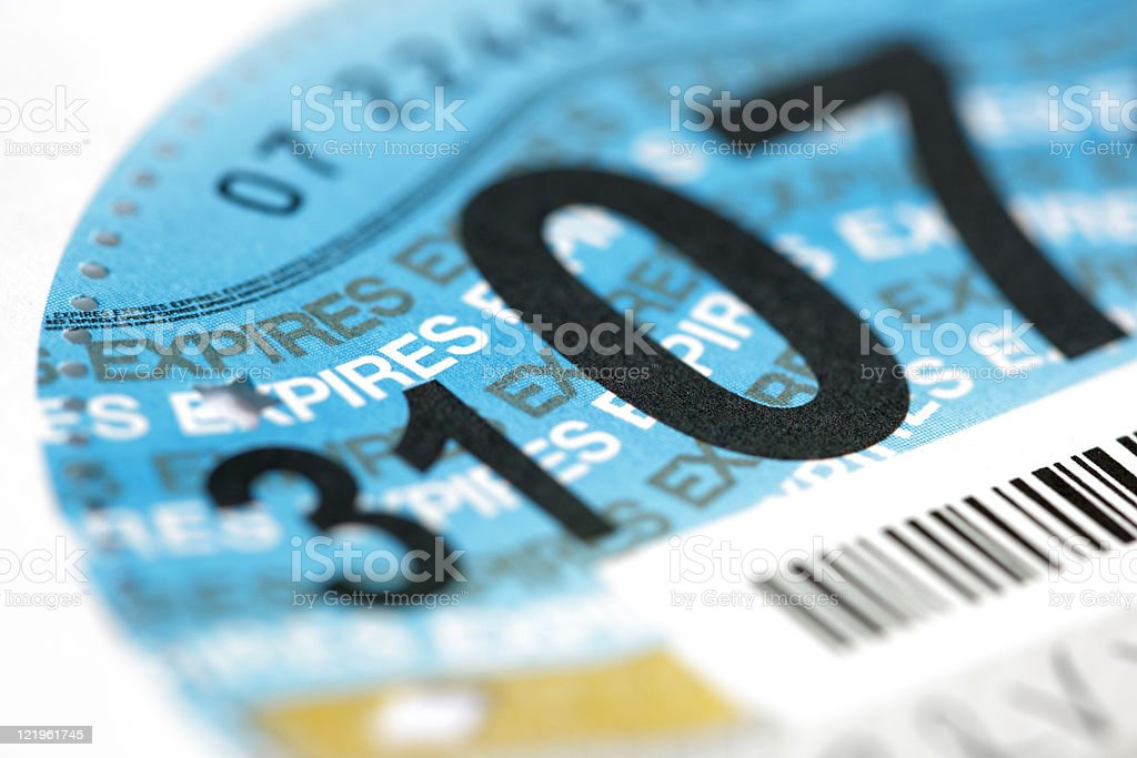 Close-up of UK road tax disk with expiration and barcode royalty-free stock photo