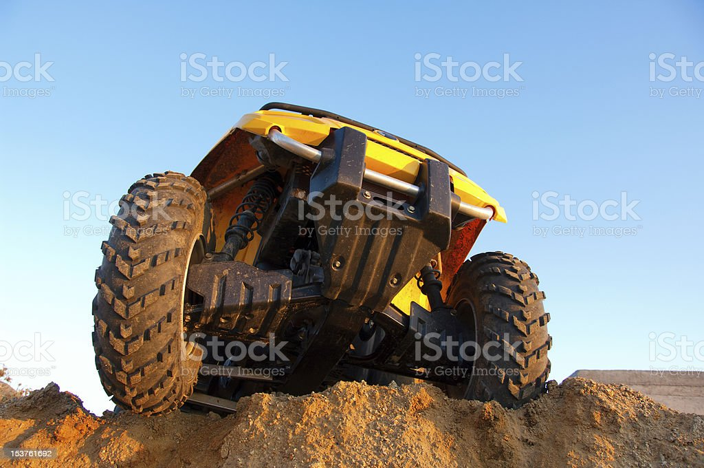 Close-up of underside of yellow dune buggy in action stock photo