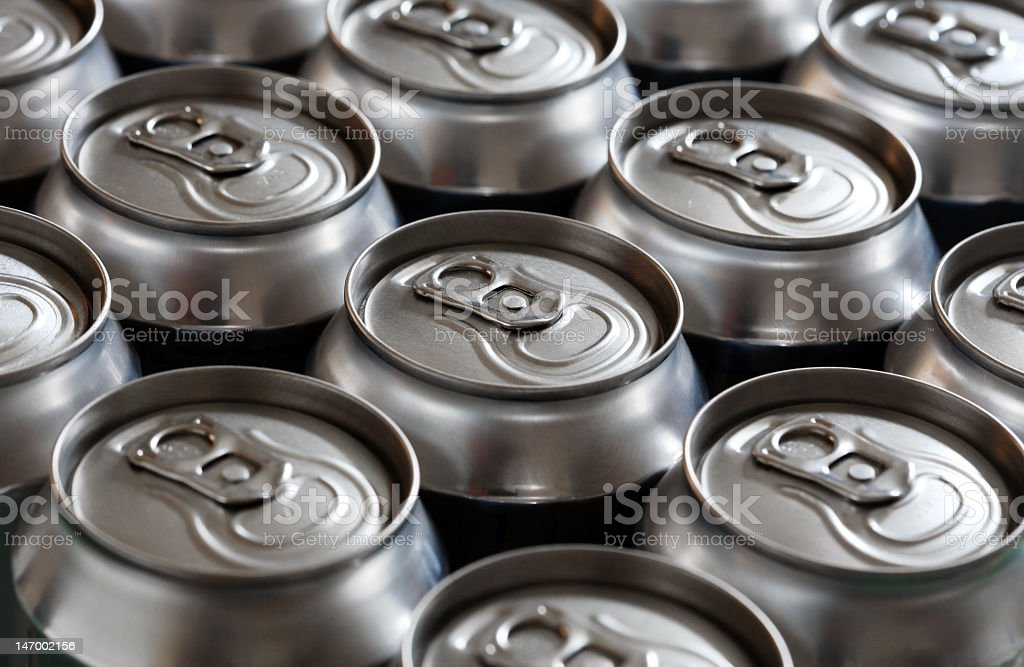Close-up of unopened aluminum can tops royalty-free stock photo