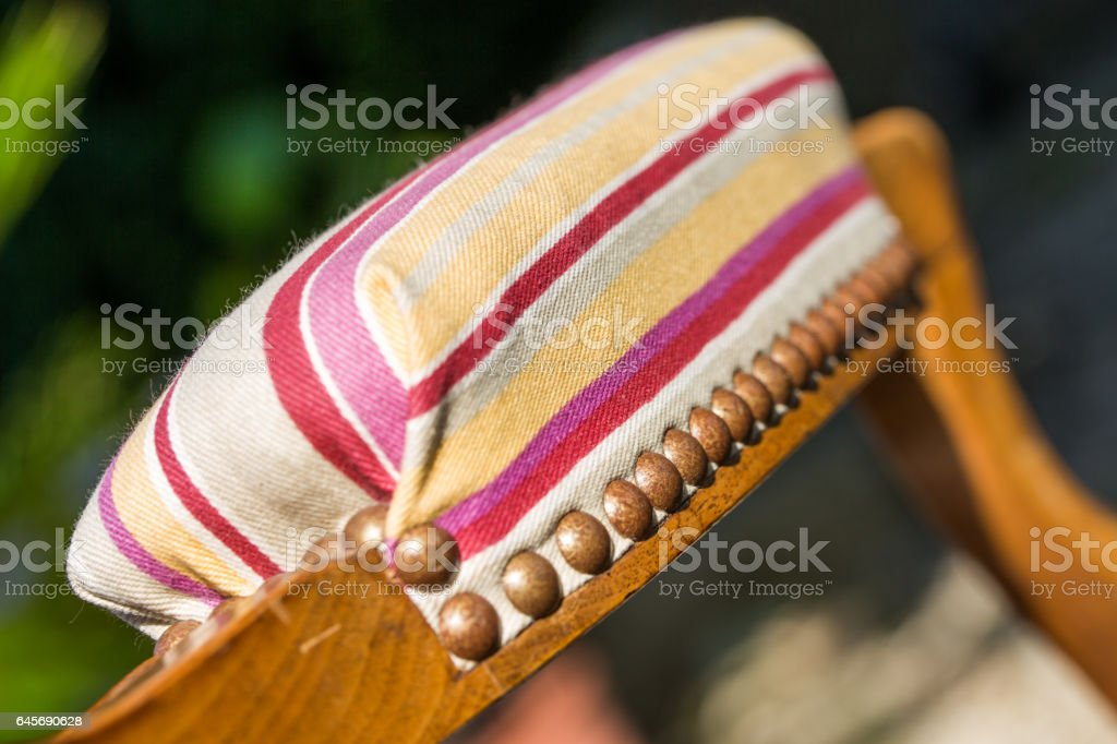 closeup of upholstery tacks on an old traditional wooden chair stock photo