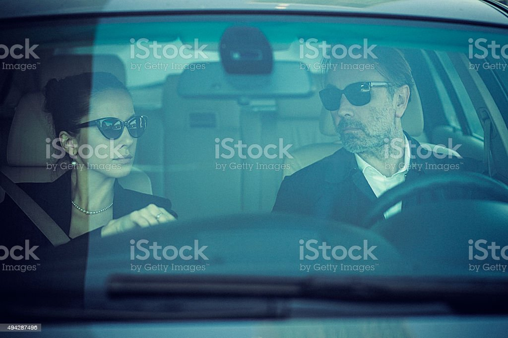Close-up of upper class couple in the car stock photo