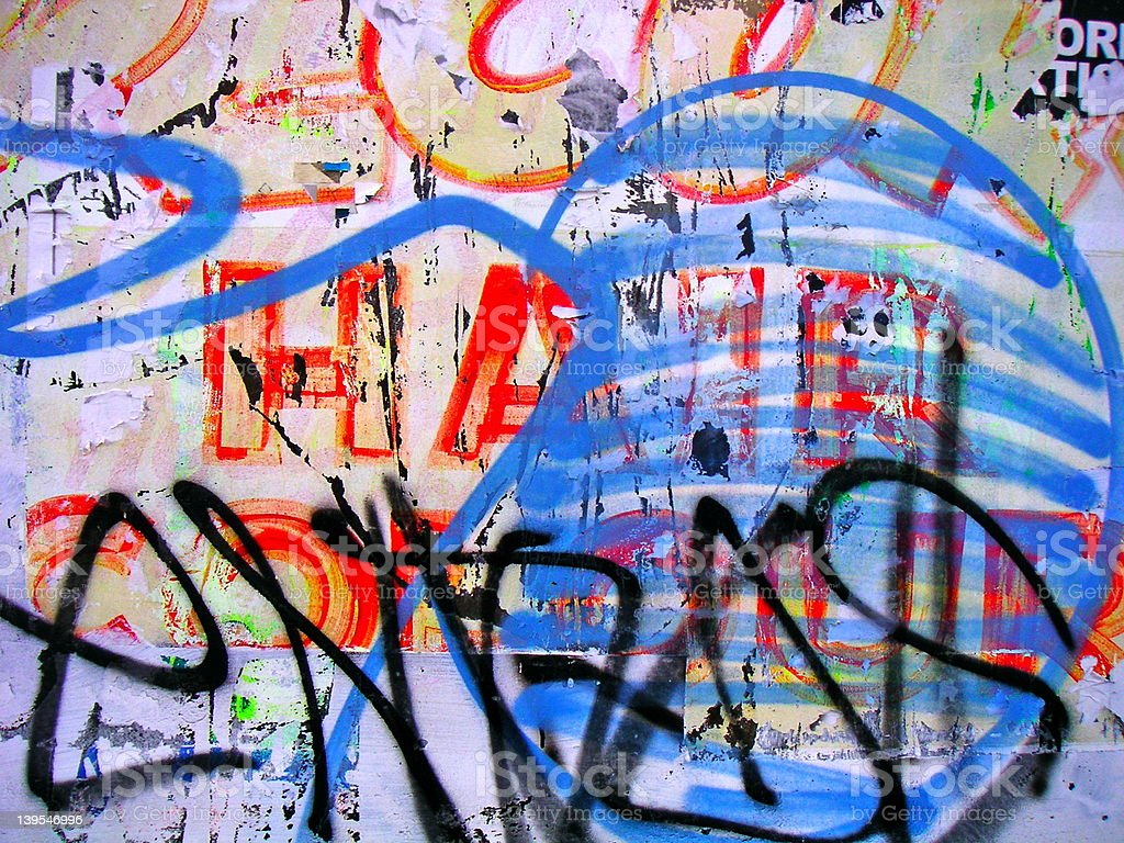 close-up of urban graffiti over faded lettering royalty-free stock photo