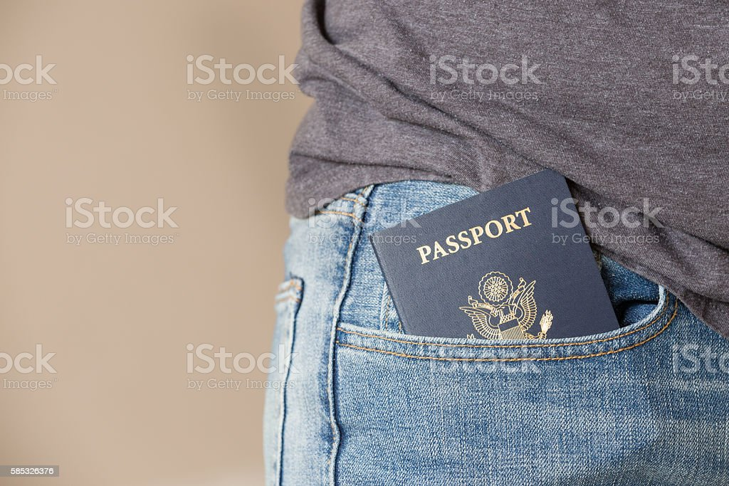 Closeup of US passport in theman's  jeans pocket. Ready stock photo