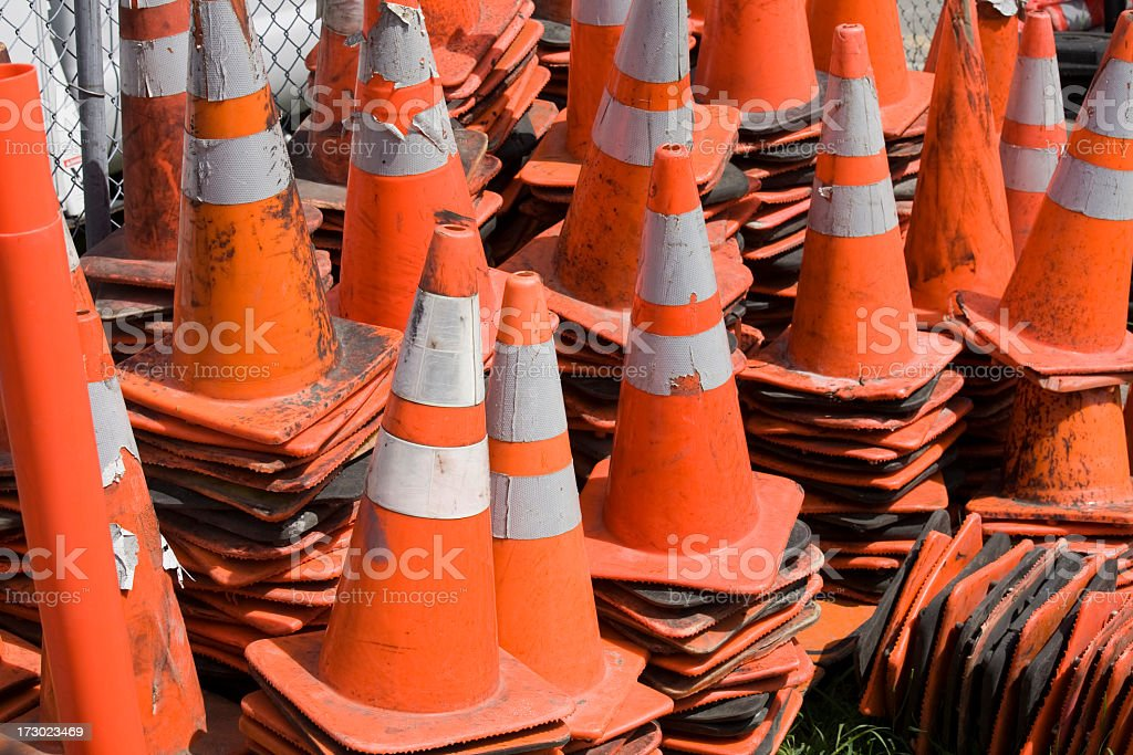 A closeup of used construction cones piled together royalty-free stock photo