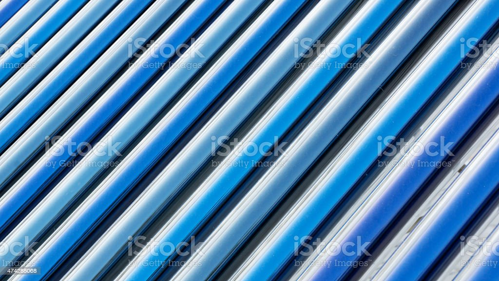 Closeup of vacuum tubes from solar water heating system. stock photo