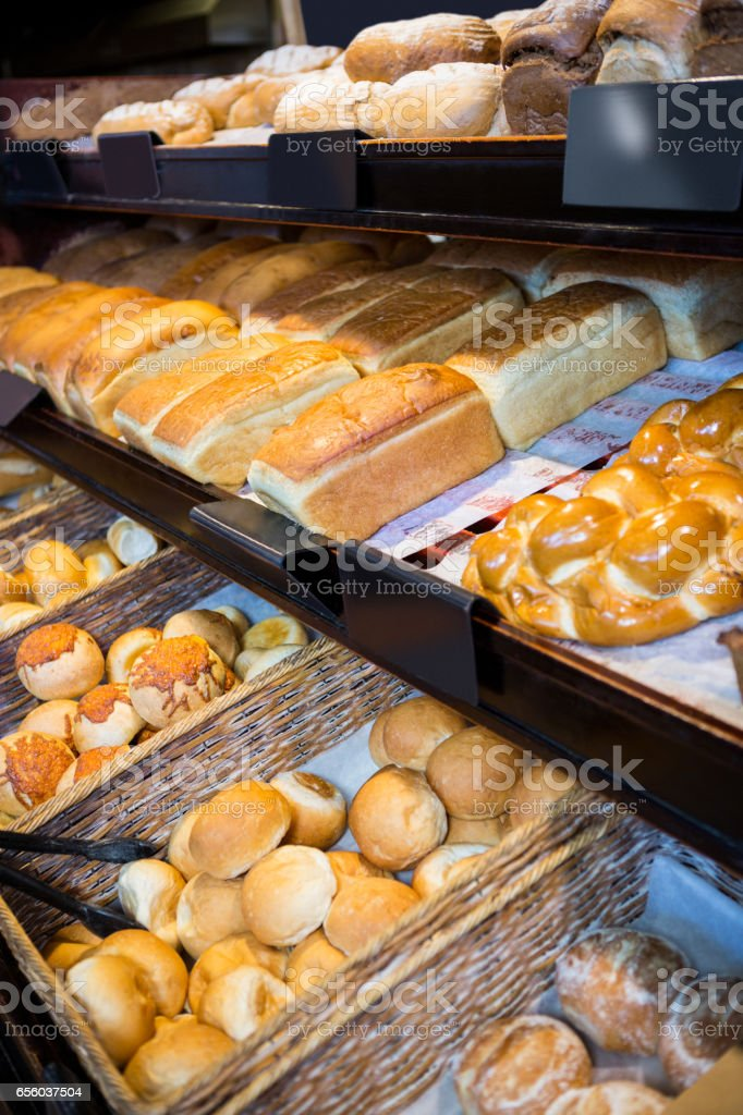 Close-up of various breads on display counter stock photo