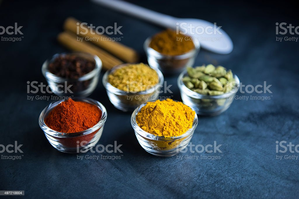 Closeup of various colorful spices bowl on table stock photo