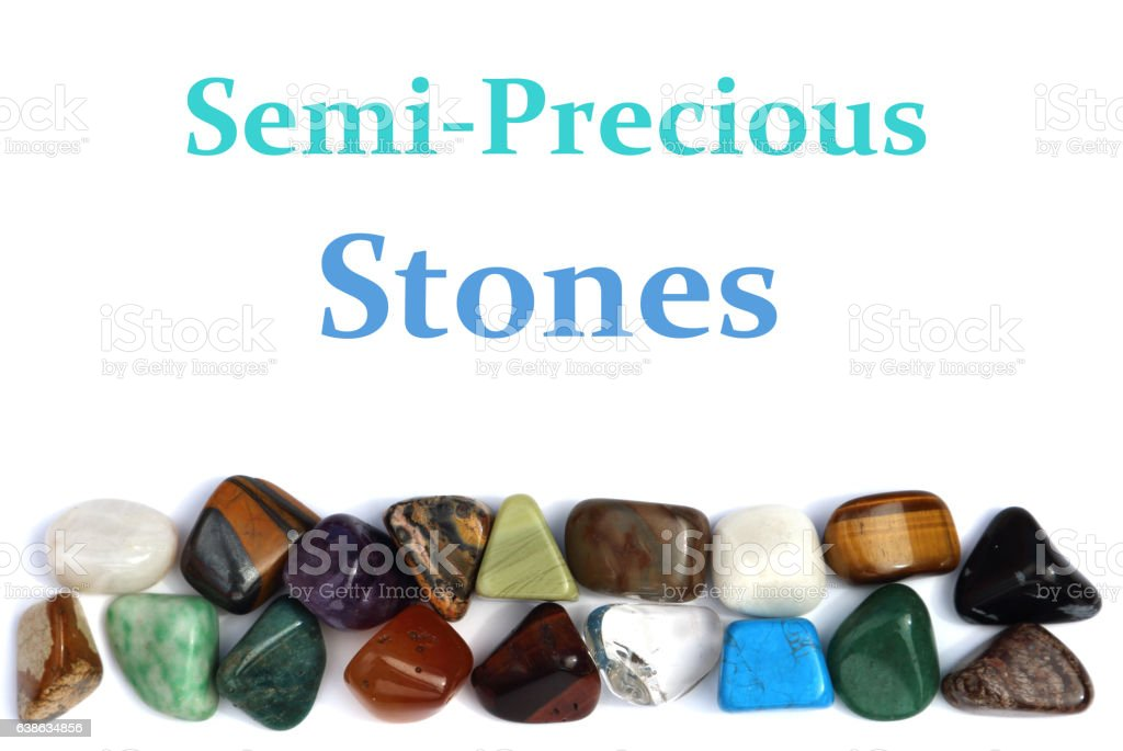 Closeup of various colorful stones over white background stock photo