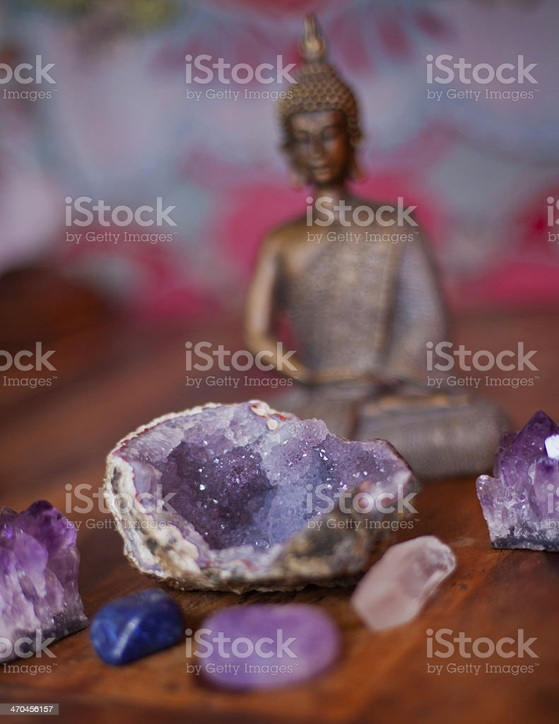 Close-up of various crystals and a Buddha in the background stock photo