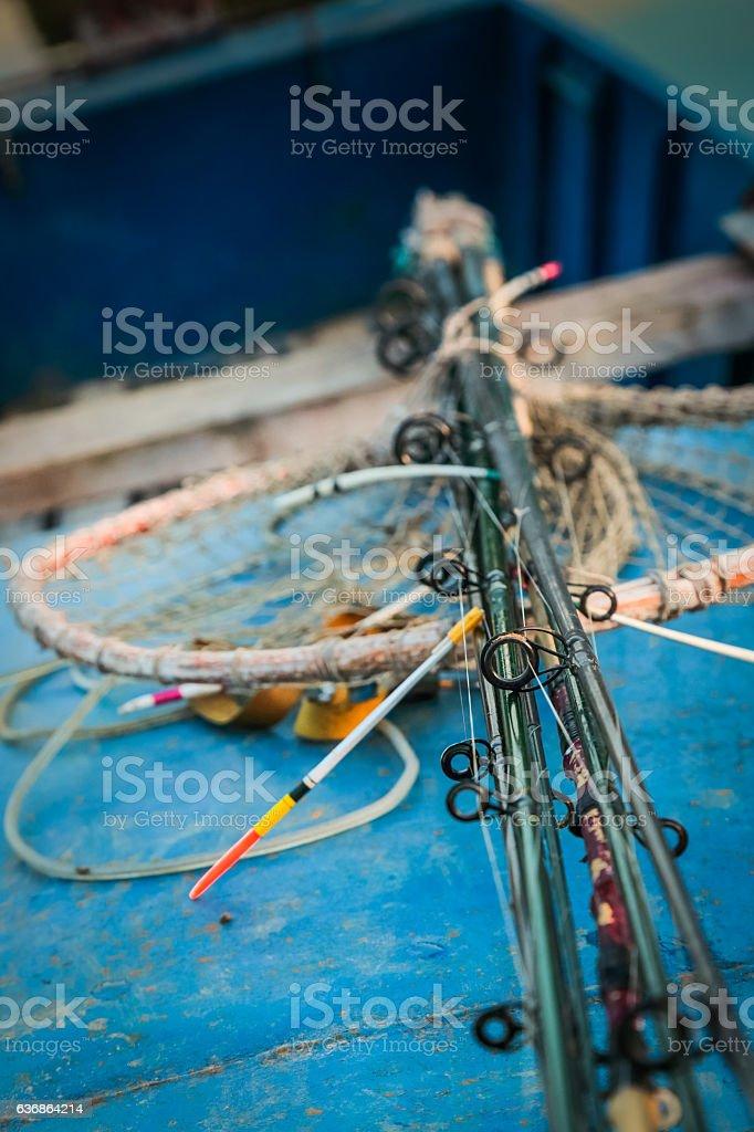 Close-up of various fishing tackles and fishing net stock photo