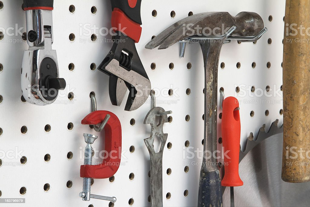 Close-up of various tools hanging stock photo