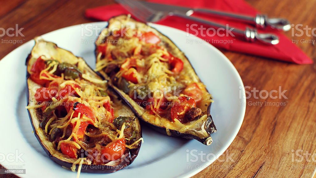 A close-up of vegan style stuffed eggplant on a plate stock photo