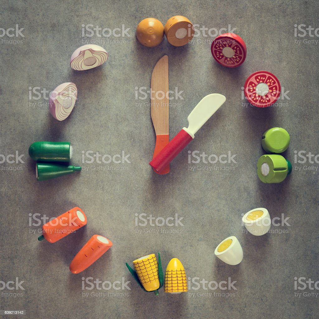 Close-up of vegetable clock pointing one o'clock, dinner, diet, retro stock photo