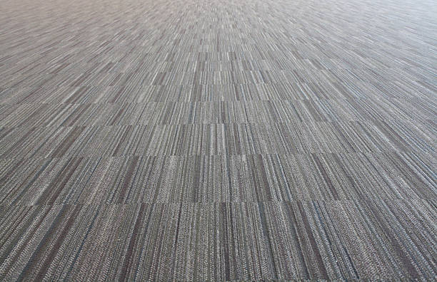 close up of vertical carpet texture with various gray tones stock photo