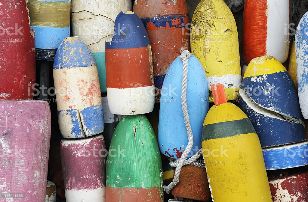 Closeup of very colorful fishing buoys stock photo