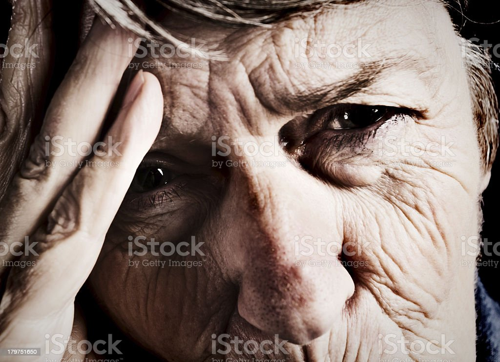 Close-up of very old woman, distressed or in pain royalty-free stock photo