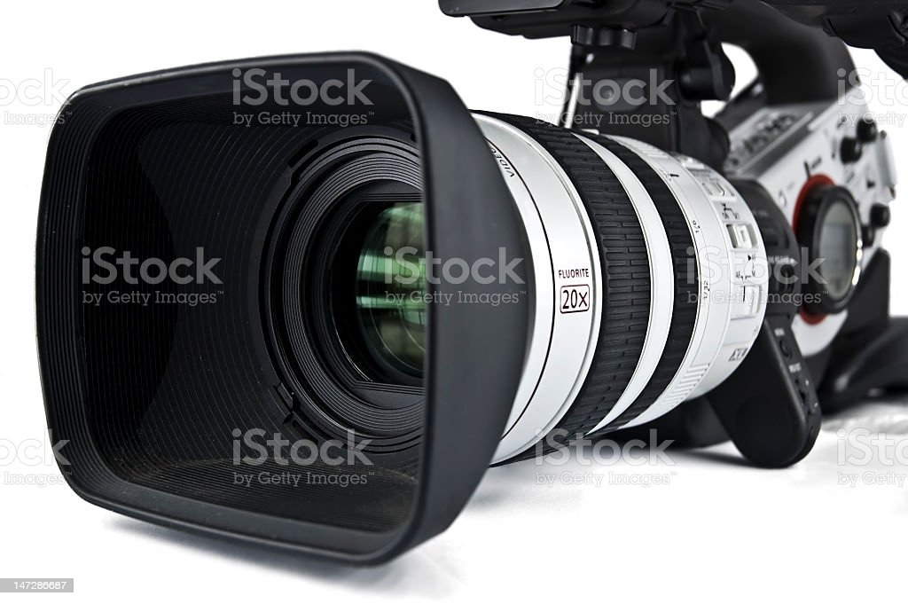 Closeup of video camera against white background stock photo