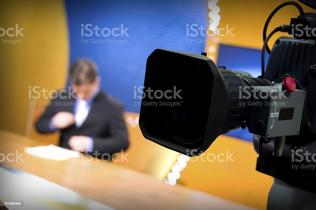 Closeup of video camera in a tv news studio royalty-free stock photo